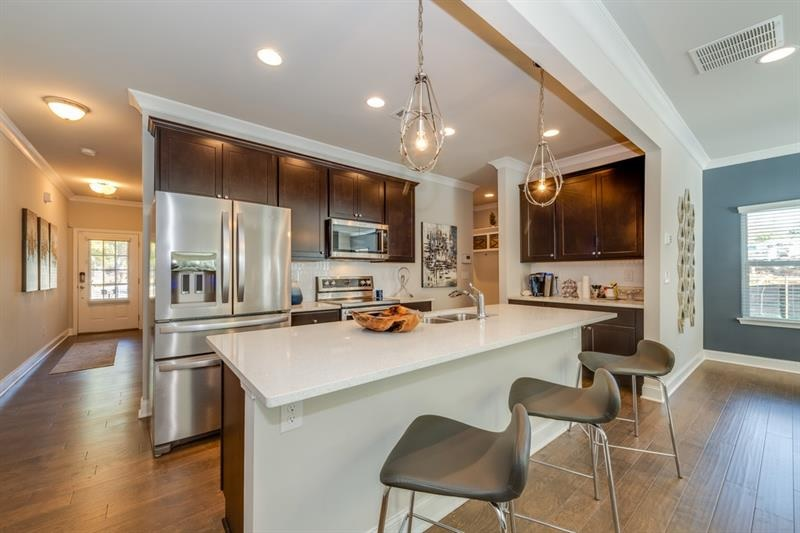 decorated model home interior - open concept kitchen